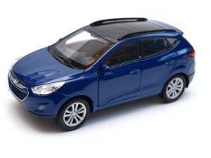 Hyundai Tucson IX - model Welly skala 1:34
